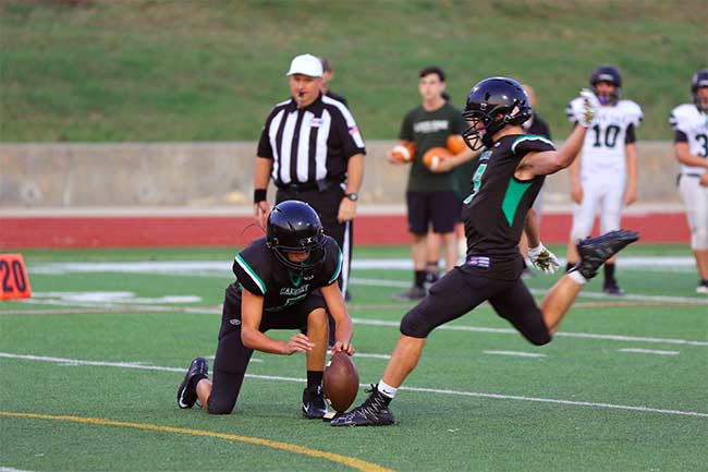 Denton Calvary's kicker takes aim.